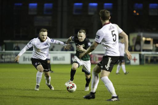 Gary McCabe bursts between Galway United duo David Cawley and Lee Grace