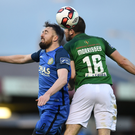 Mark Salmon of Bray Wanderers and Gearóid Morrissey of Cork City battle for the ball in the air