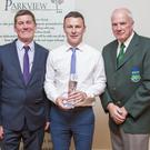 John Shea and Michael Conlon present Leighton Glynn of Rathnew AFC with the Overall Player of the Year Award at the Wicklow and District League Awards in the Parkview Hotel, Newtown