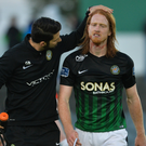 Hugh Douglas of Bray Wanderers leaves the field after picking up an injury against Dundalk