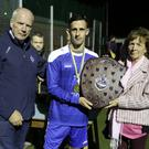 Michael Conlon Chairman of the Wicklow League, Ashford Captain Danny Byrne accepts the Tommy Heffernan shield from his wife Margaret