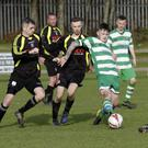 Shane Walker of Arklow Celtic is surrounded by Arklow United trio Karl Kirwan, Jonny Quinn and David O'Neill.