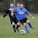 Justin Melia of Ballywaltrim tracks Eoin Murtagh of Conary United
