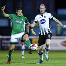 Jake Kelly of Bray Wanderers in action against Chris Shields of Dundalk