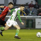 Luke McNally of Drogheda United chasing Dylan McGlade as he breaks free for his second goal