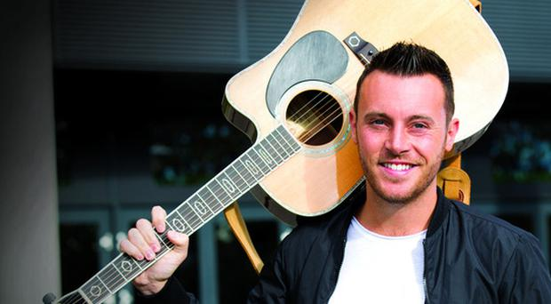 Shelter from the storm - Nathan Carter performed impromptu session for people holed up in Cork during Ophelia