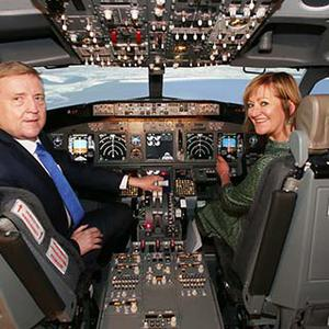 Minister Pat Breen and Breda Fox of the Local Enterprise Offices pictured inside an aircraft simulator at Simtech Aviation in Fingal, which won the National Enterprise Awards in 2008 (Leon Farrell, Photocall Ireland)