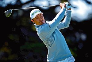 Haotong Li plays his shot from the 14th tee during the second round of the US PGA Championship yesterday as he surged into an early lead thanks to a superb 65. Photo: USA TODAY Sports
