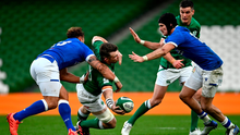 Magic moment: Ireland flanker Peter O'Mahony offloads out of a tackle by Italy's Federico Mori in the build-up to a try by Bundee Aki. Photo: Sportsfile