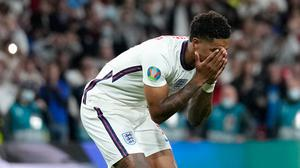 Marcus Rashford reacts after missing his penalty against Italy