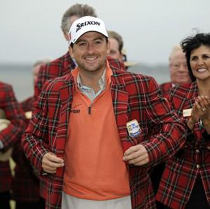 Graeme McDowell, centre, is up to eighth in the world rankings after winning the RBC Heritage (AP)