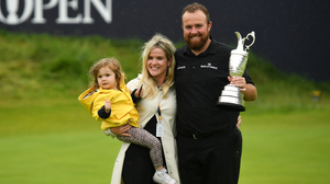 Shane Lowry is pictured with his wife Wendy and daughter Iris after winning the Open Championship at Royal Portrush last July. Photo: Sportsfile