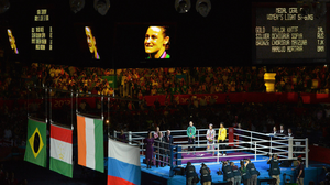 Katie Taylor takes her place on the podium at the ExCel Arena in London after claiming the Olympic gold medal in 2012. Photo: Sportsfile
