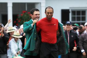 Tiger Woods is awarded the green jacket last year