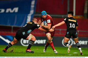 Tadhg Beirne of Munster in action against Wilco Louw, left, and Marcus Smith of Harlequins during the Heineken Champions Cup Pool B Round 1 match between Munster and Harlequins at Thomond Park