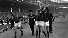 Manchester United captain Noel Cantwell (centre) celebrating his team's 1963 FA Cup victory with Maurice Setters (left) and Pat Crerand. The third round, scheduled for January 5, was eventually completed on March 11. Photo: Dennis Oulds