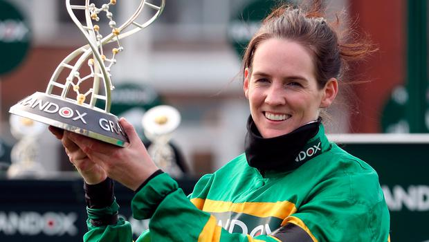 Rachael Blackmore holds the Grand National trophy. PA