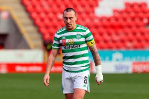 Scott Brown looks dejected after Celtic conceded an injury-time goal. PA WIRE
