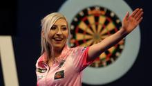 Fallon Sherrock celebrating after becoming the first women to win a game in the PDC William Hill World Championship during day five of the William Hill World Championships at Alexandra Palace, London.