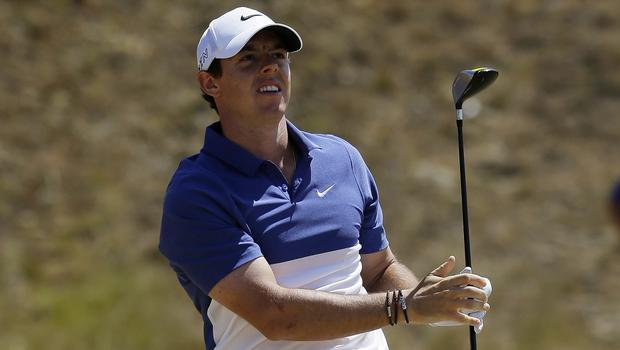 Paul McGinley believes Rory McIlroy, pictured, needs to up his game to remain number one (AP)