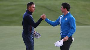 Rory McIlroy, right, and Rickie Fowler could not be separated after day one in Abu Dhabi