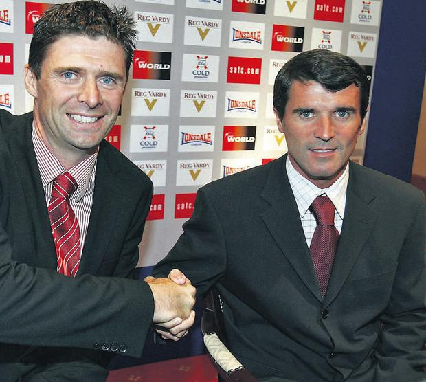 Sunderland chairman Niall Quinn shakes hands with new manager Roy Keane during a press conference at the Stadium of Light