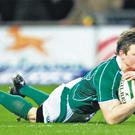 Ireland captain Brian O'Driscoll scores his side's second try against France at Croke Park in 2007. Ireland won 30-21