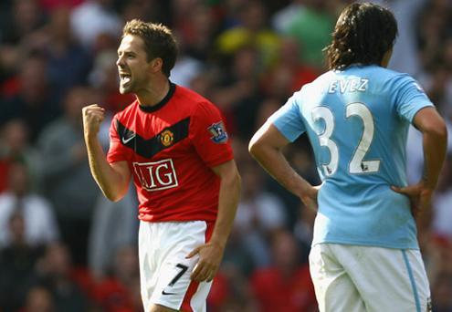 Michael Owen of Manchester United celebrates scoring the winning goal in injury time during the Barclays Premier League match between Manchester United and Manchester City in 2009