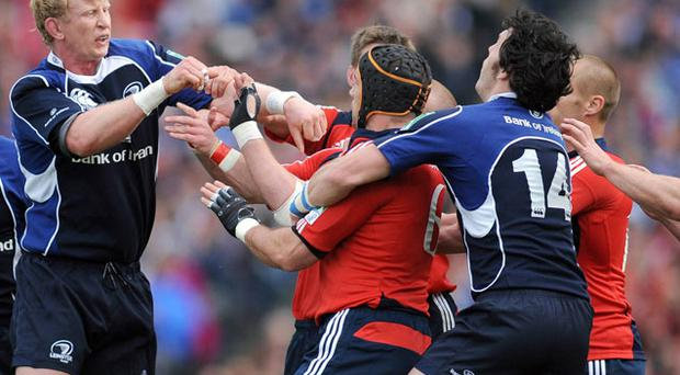 Leinster's Leo Cullen and Munster's Alan Quinlan get to grips with each other during the Heineken Cup semi-final in 2009.