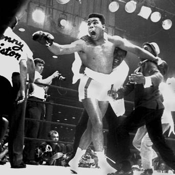 Cassius Clay celebrates after winning the heavyweight championship of the world on 25 February 1964. Clay won after Sonny Liston failed to answer the bell in the eighth round. The next day Clay became Muhammad Ali after converting to Islam.