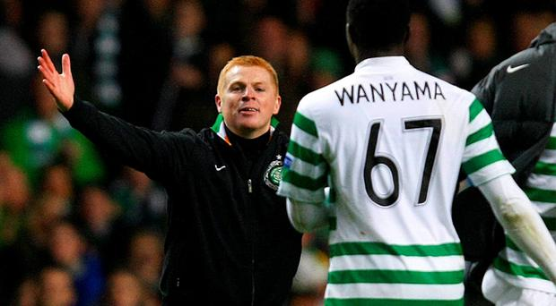 Celtic manager Neil Lennon goes to celebrate victory over Barcelona with Victor Wanyama last season. Photo: Reuters