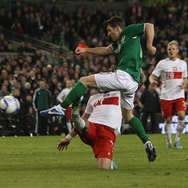 Wes Hoolahan, right, scores the second goal of the game against Poland
