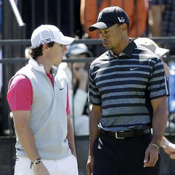 Rory McIlroy, left, remained seven shots behind clubhouse leader Tiger Woods (AP)