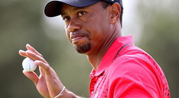 Overnight leader Tiger Woods won by two shots in Miami