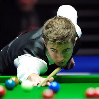 Jack Lisowski, pictured, sealed a last-16 clash with Tom Ford at the PTC Grand Finals