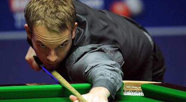 Ali Carter, pictured, moved into the last 16 with victory over John Higgins