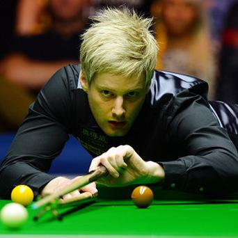 Neil Robertson claimed a routine win over Barry Hawkins