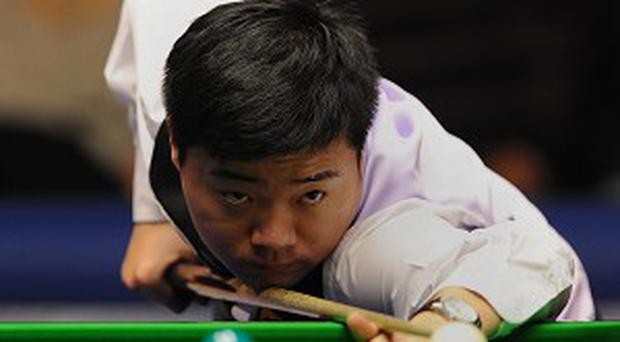 Ding Junhui, pictured, faces Neil Robertson in the final of the Dafabet Players Tour Championship Grand Finals