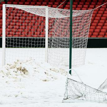 The Windsor Park pitch was still covered in snow on Saturday morning