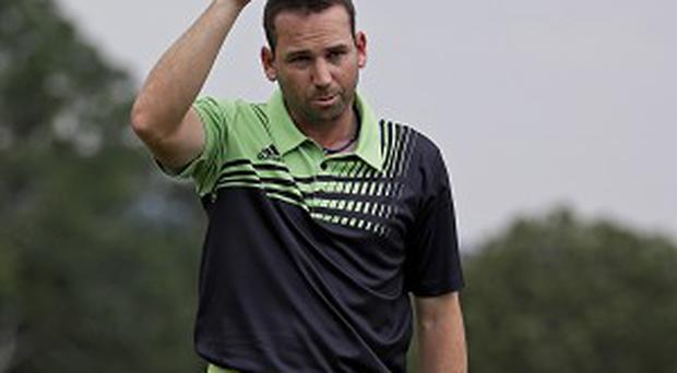 Sergio Garcia tips his cap on the 18th after taking a share of the lead (AP)