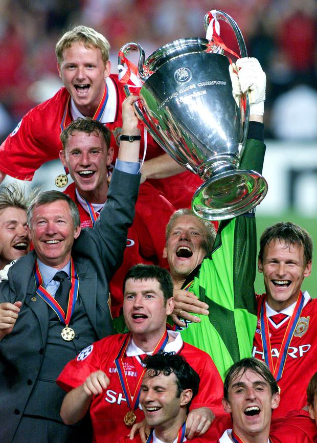 Teddy Sheringham and team mates celebrate their dramatic Champions League success in 1999