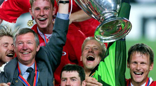 Alex Ferguson, Denis Irwin, Ryan Giggs and team mates celebrate their dramatic Champions League success in 1999
