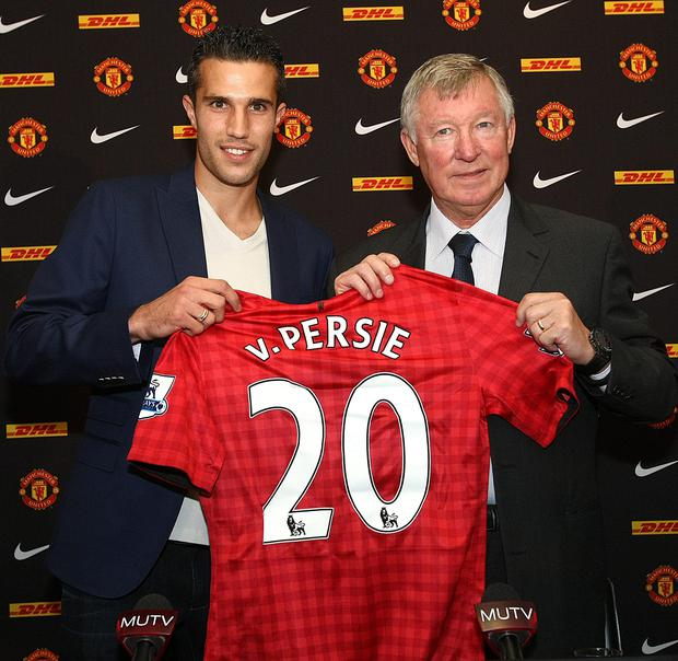 New signing Robin Van Persie (left) with manager Sir Alex Ferguson following a press conference at Old Trafford, Manchester in August 2012.