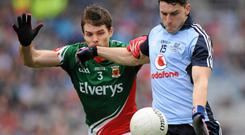 Dublin's Bernard Brogan in action against Ger Cafferkey, Mayo
