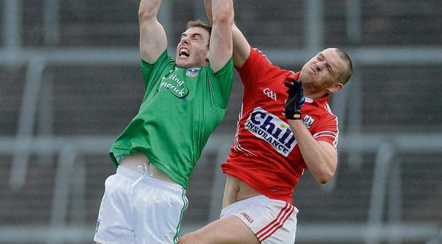 Seanie Buckley, Limerick, in action against Pearse O'Neill, Cork