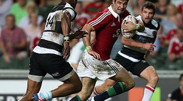 Mike Phillips, second right, races clear to score one of his two tries