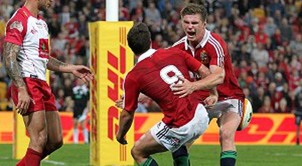 Ben Youngs, centre, scored the Lions' only try while Owen Farrell, right, kicked 17 points