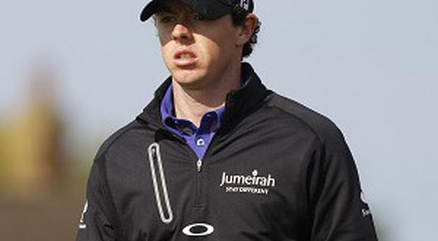 Rory McIlroy, right, is four shots off the lead at Merion
