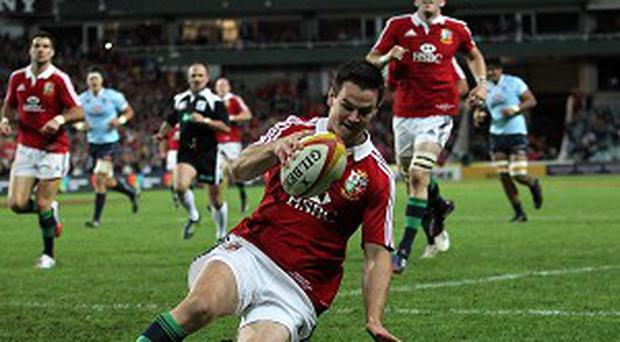 Jonathan Sexton touches down in the corner for the Lions' first try