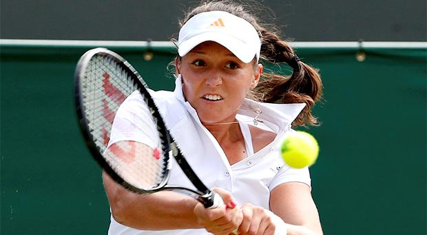 Laura Robson of Britain hits a return to Marina Erakovic of New Zealand in their women's singles tennis match at the Wimbledon Tennis Championships